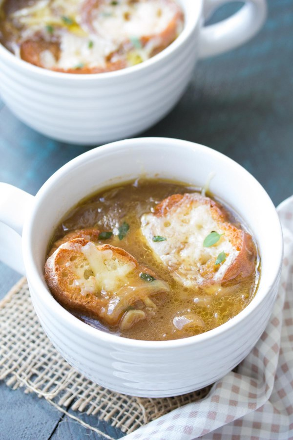 A simple French onion soup recipe, with just four easy steps! With caramelized onions, a rich and hearty broth, and toasted cheesy bread!   www.kristineskitchenblog.com