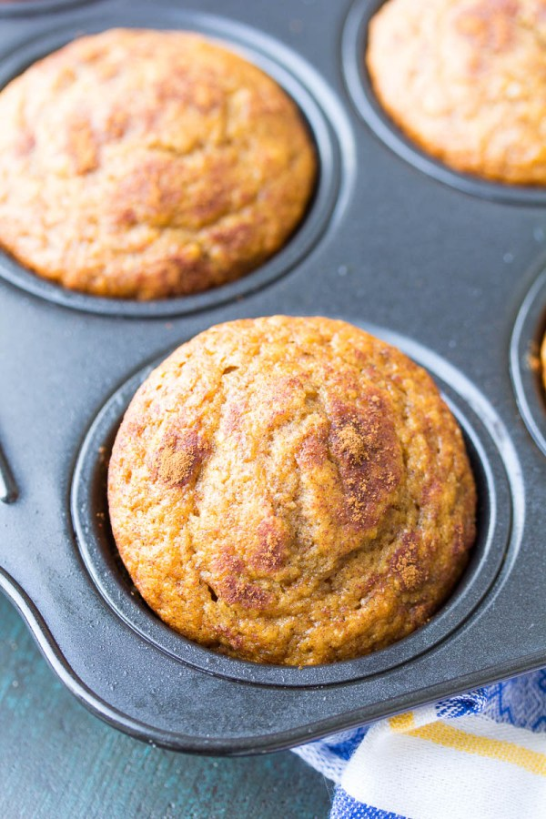 Baked banana muffins in a muffin tin.