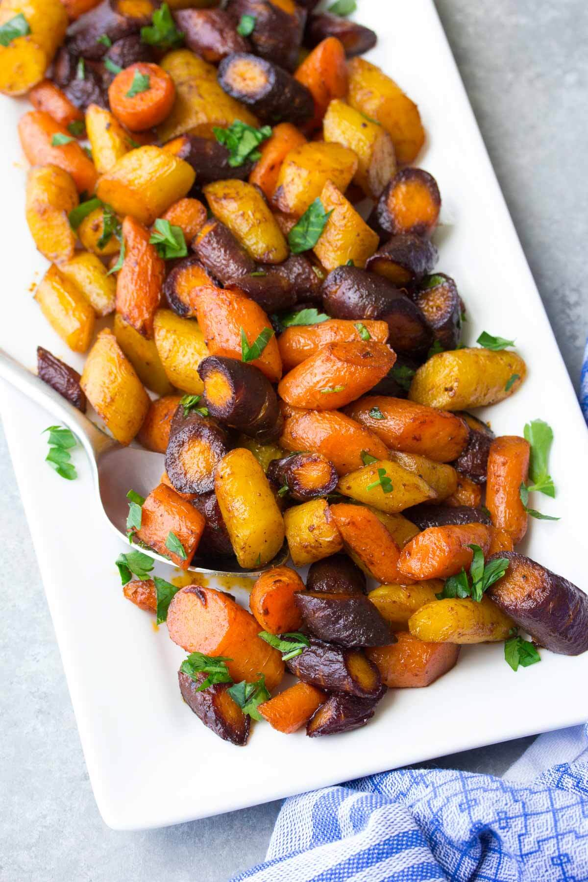 chopped roasted carrots on white serving tray