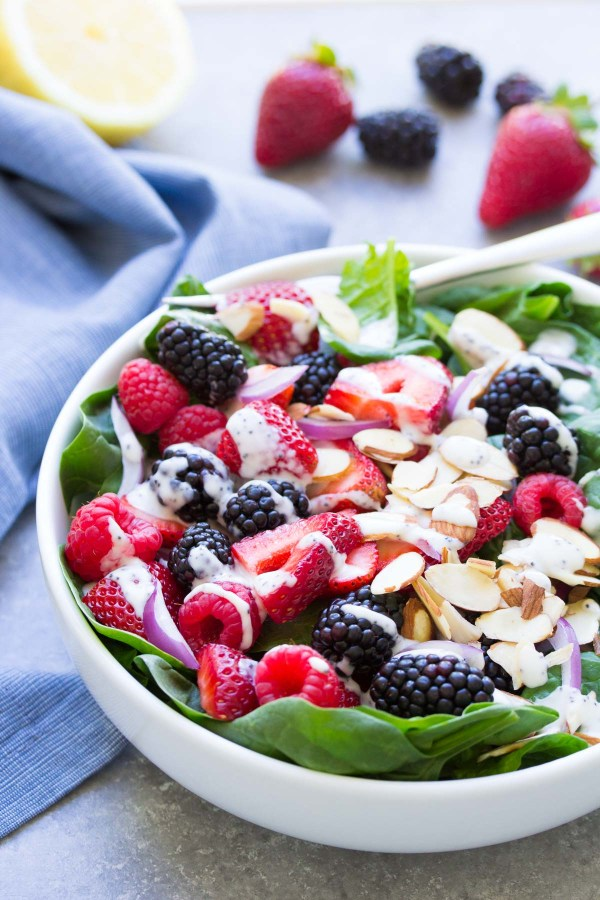 Triple Berry Spinach Salad with Creamy No Mayo Poppy Seed Dressing. A light and healthy vegetarian salad.