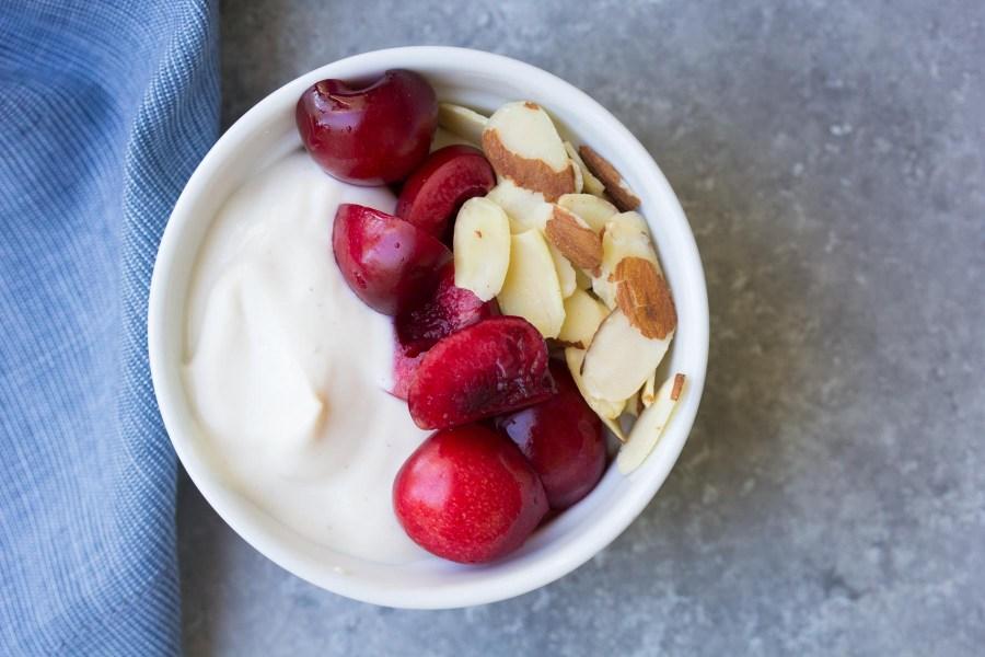 Dairy free cherry vanilla almond yogurt breakfast bowl.