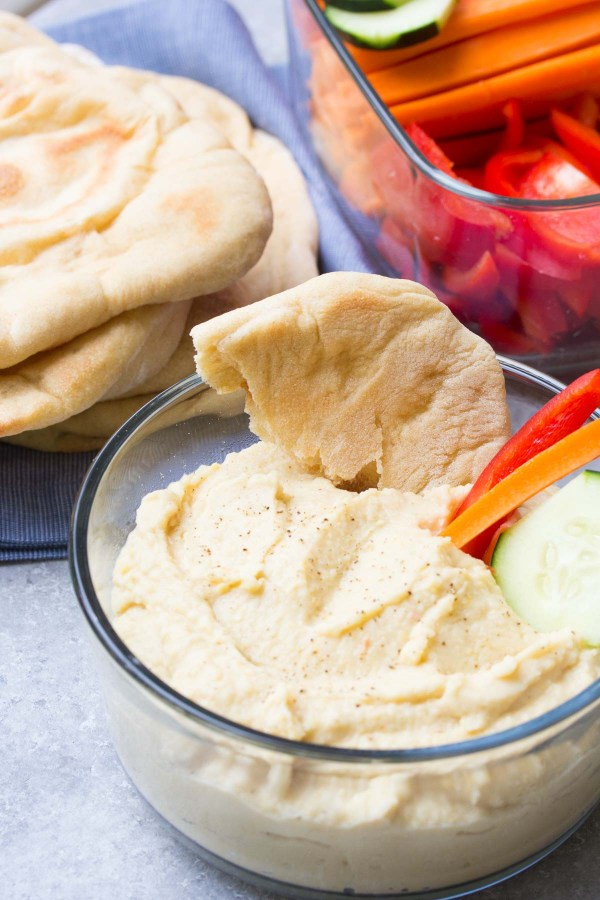 An easy recipe for homemade whole wheat pita bread, made with just a few pantry ingredients. You will love how soft and flavorful this pita bread is!