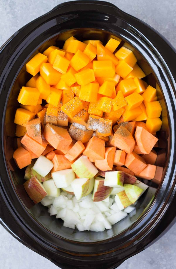 A healthy vegetarian and vegan soup made in the crock pot. This Slow Cooker Butternut Squash and Sweet Potato Soup is an easy make ahead dinner idea!