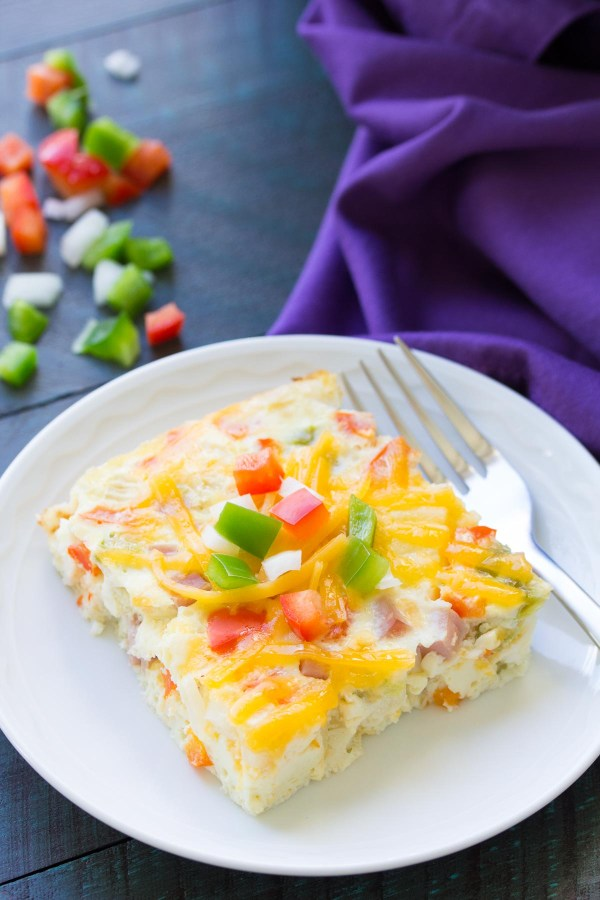 This Slow Cooker Ham, Cheese and Veggie Frittata is an easy make ahead breakfast! This crockpot egg casserole is also a great way to use up leftover ham. It's like a Denver omelet!