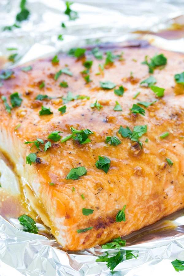 Baked salmon filet with honey garlic glaze on a pan.