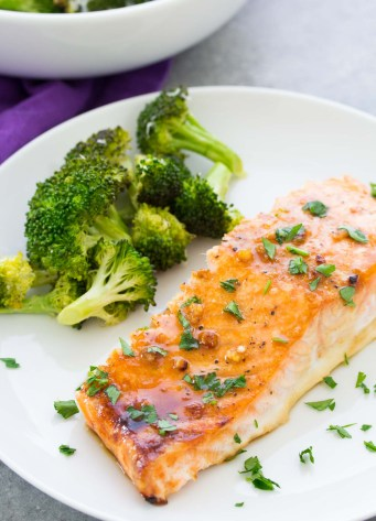 Honey garlic baked salmon served with broccoli.