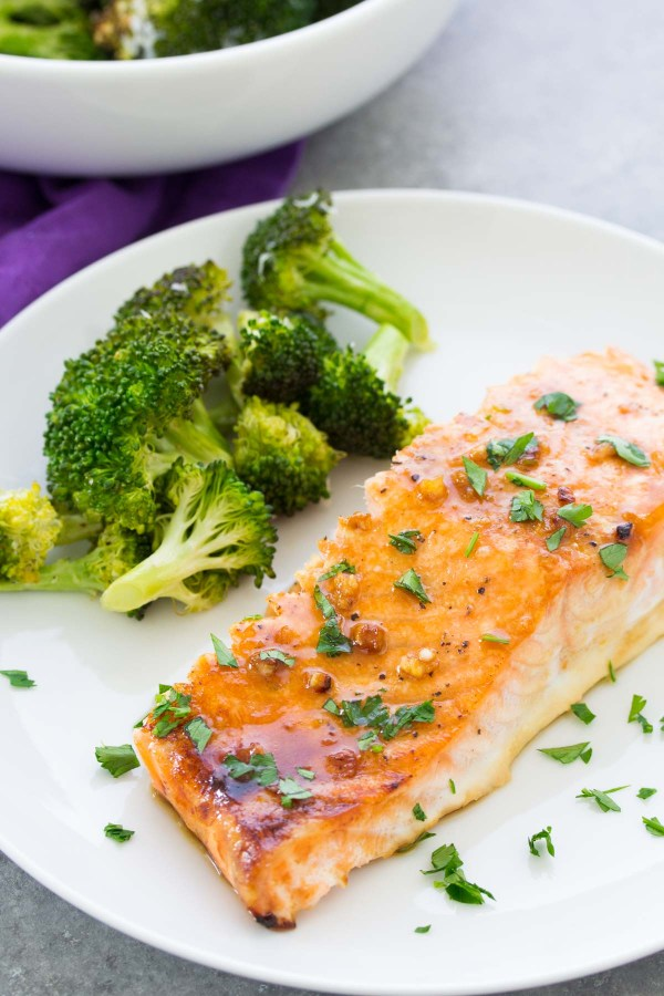 Baked salmon with honey garlic sauce on a plate with broccoli. Easy salmon recipe.