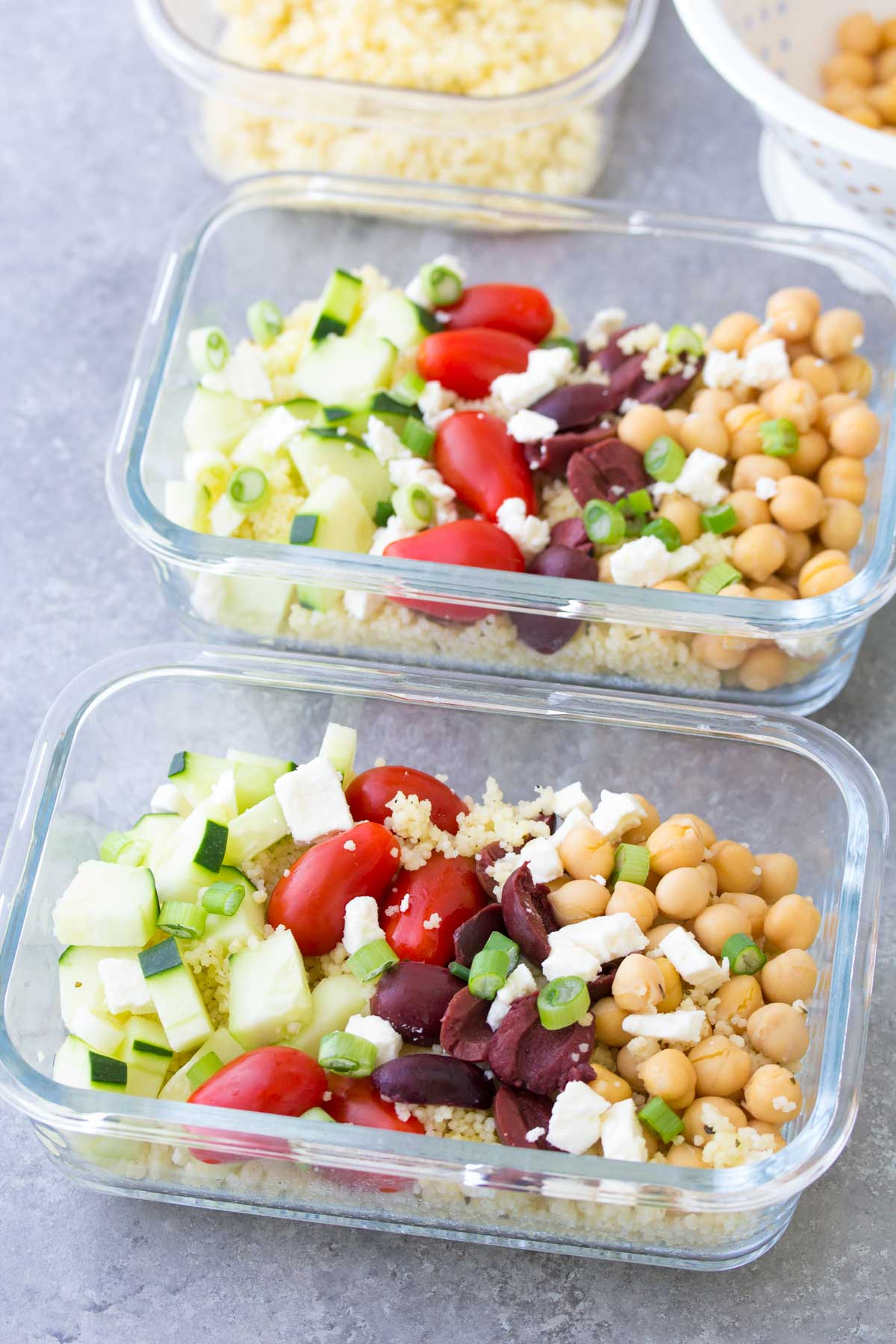 This Meal Prep Greek Chickpea Salad is a healthy, vegetarian make ahead lunch. These lunch bowls are filled with healthy vegetables and chickpeas add protein! You can also serve this as a side salad at a BBQ.