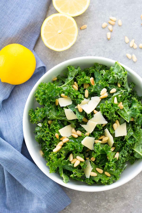 This Lemon Parmesan Kale Salad with toasted pine nuts is our favorite easy kale salad! It is just as good the second day for a healthy meal prep lunch.