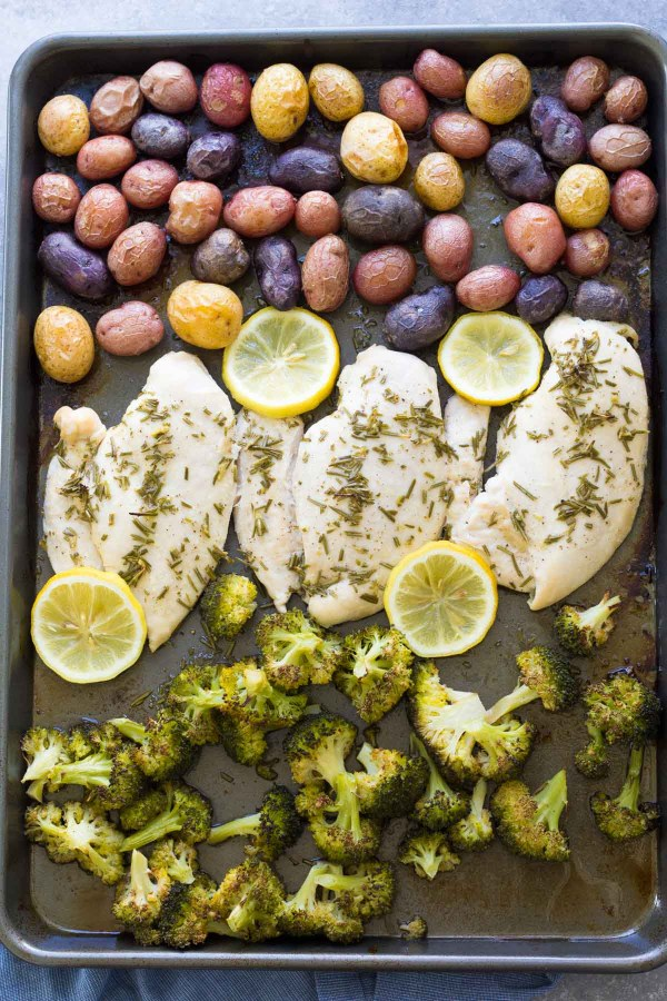 This One Pan Baked Chicken and Vegetables is an easy 30 minute dinner recipe. The chicken is seasoned with lemon and rosemary, and the whole meal cooks on one sheet pan for easy clean up!