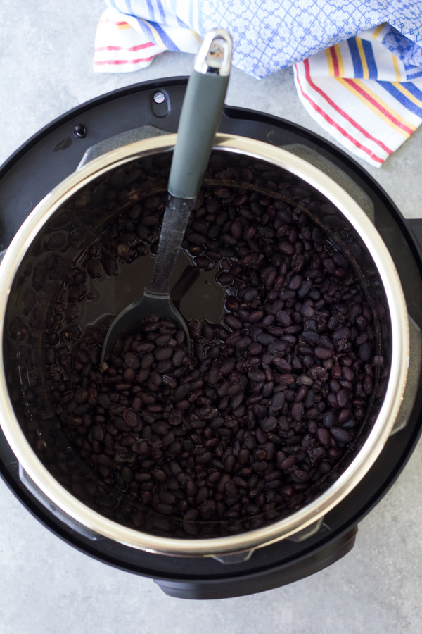 These Mexican black beans are easy to make in your Instant Pot or pressure cooker, with no soaking required! These Instant Pot Black Beans freeze well so you can meal prep a big batch. This post also includes directions for how to cook dried black beans in your Instant Pot for baking (without seasoning). Recipe is vegan and an easy way to cook dried beans.
