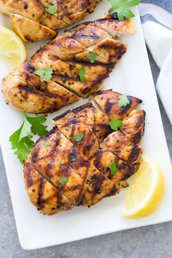 A simple marinade and easy tips for grilling makes this easy grilled chicken recipe the BEST. Make these flavorful, juicy chicken breasts for dinner tonight!