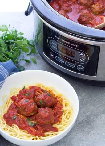 Crockpot Meatballs in bowl with spaghetti