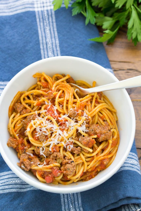 bowl of Instant Pot Spaghetti with meat sauce and Parmesan cheese on top