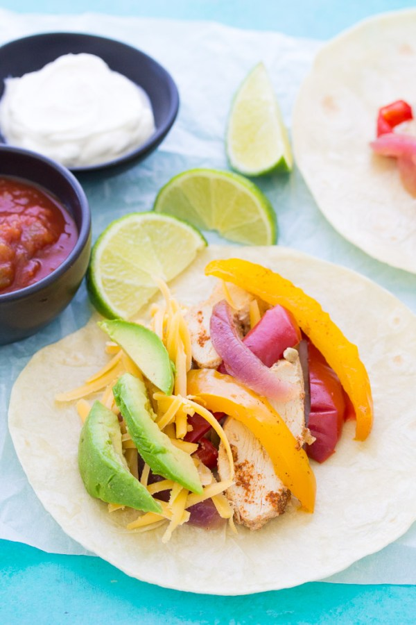 The best easy healthy crockpot chicken fajitas recipe! This simple fajita recipe has tender, juicy chicken and lots of flavor. The ingredients can be frozen and then cooked in your slow cooker!