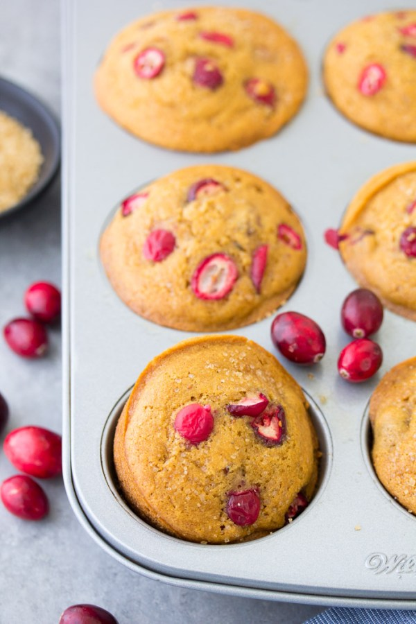 Cranberry Orange Muffins in a muffin pan.