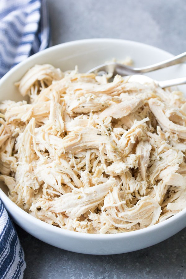 How to shred chicken - shredded chicken in a bowl.