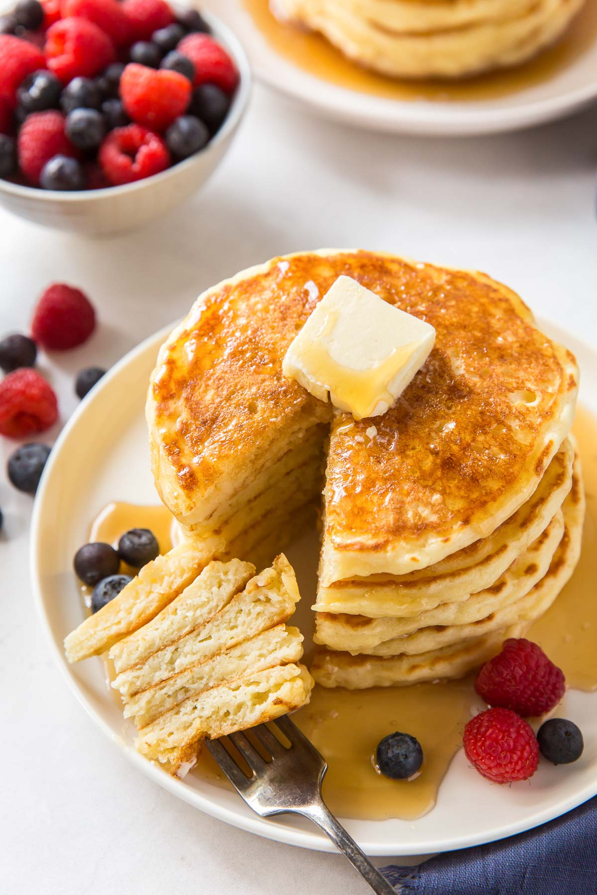 stack of pancakes with a bite on a fork