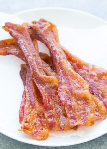 Crispy oven cooked bacon on a plate.