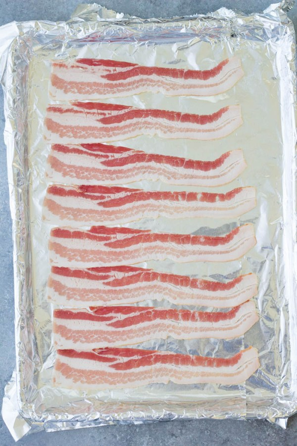 Bacon on a foil-lined baking sheet pan.