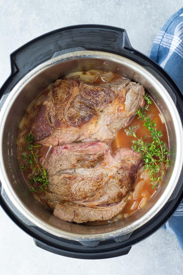 Pressure cook the beef chuck roast in broth with seasonings before adding the potatoes and carrots. How to cook pot roast in a pressure cooker.