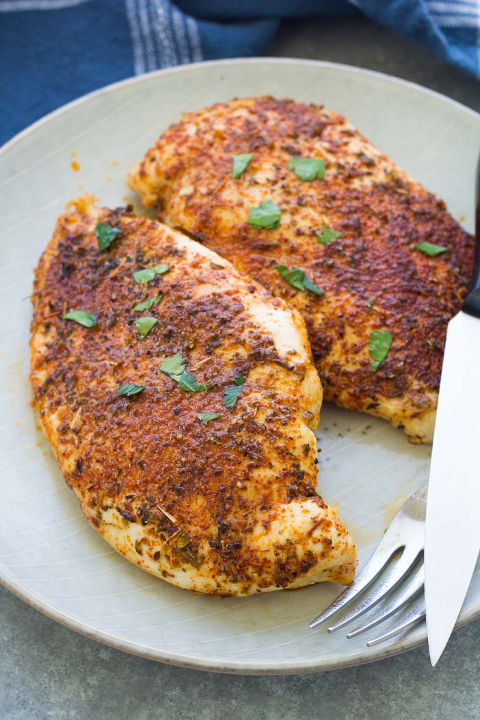 Baked chicken breasts on a plate.