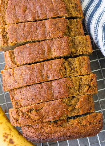 A loaf of the best healthy banana bread, sliced. So moist, sweet and full of banana flavor.
