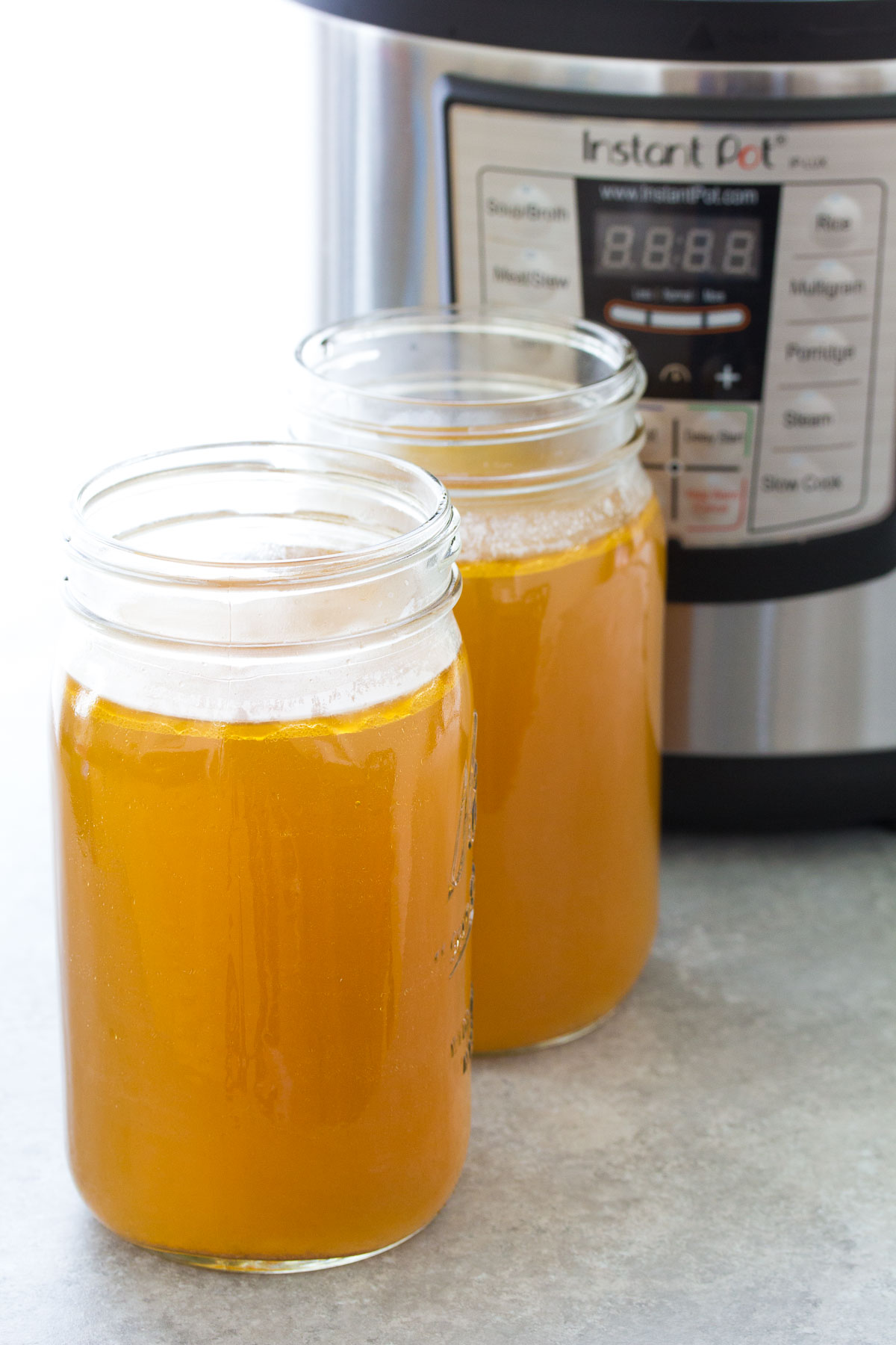 instant pot bone broth in large mason jars