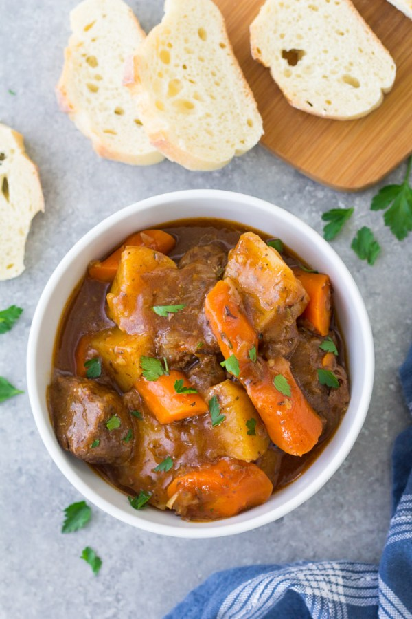 Rich and flavorful Instant Pot Beef Stew served in a bowl with bread.