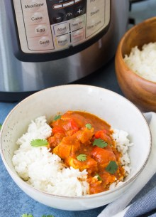 Instant Pot butter chicken curry served with rice, with an Instant Pot pressure cooker.
