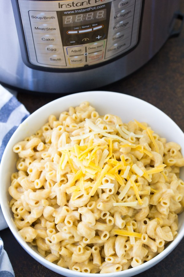 A bowl of Instant Pot mac and cheese next to an Instant Pot.