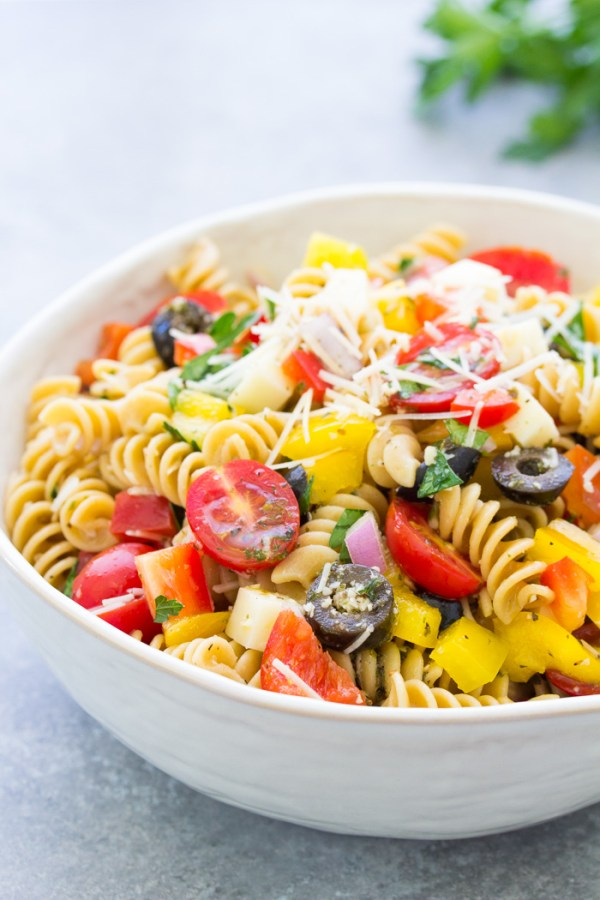 Side view of pasta salad in a white bowl.