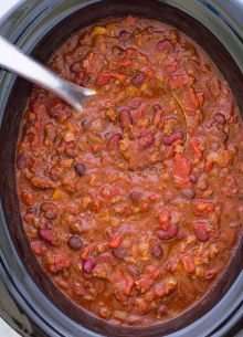 Chili in a slow cooker with a ladle.