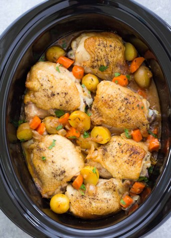 Crockpot chicken and potatoes with carrots and gravy.