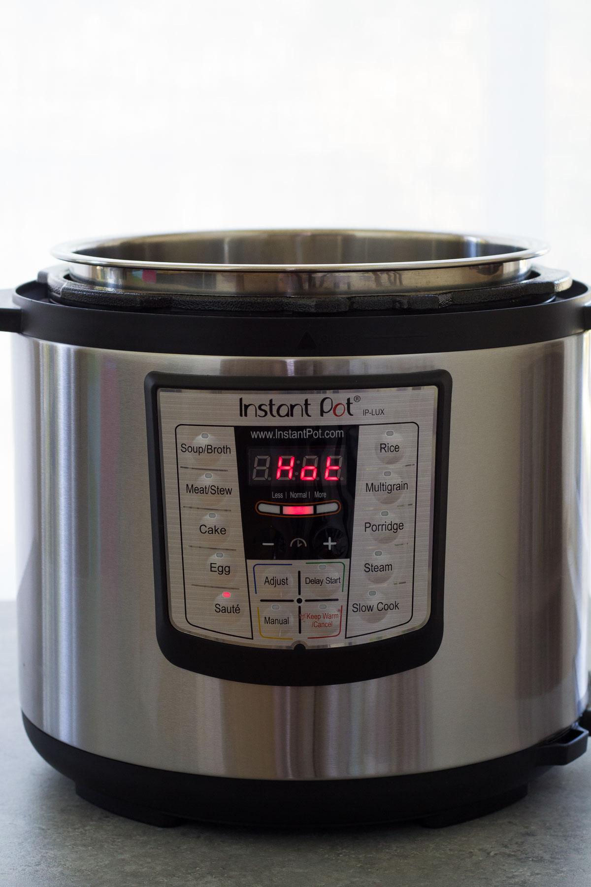 "Instant Pot display shows ""Hot."""