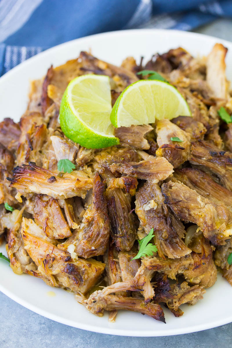 Instant Pot carnitas on a plate with lime.