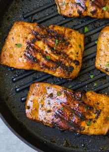 Cooking salmon on a grill pan.