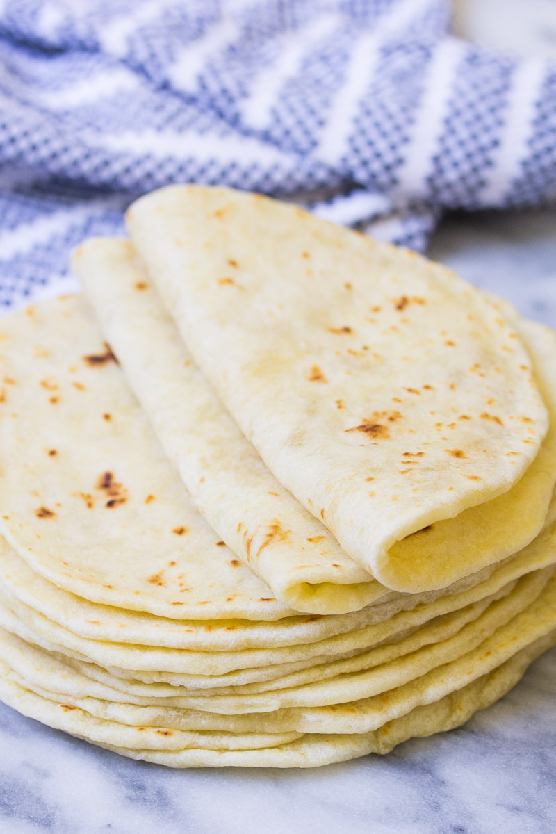 Two folded tortillas on top of a stack.