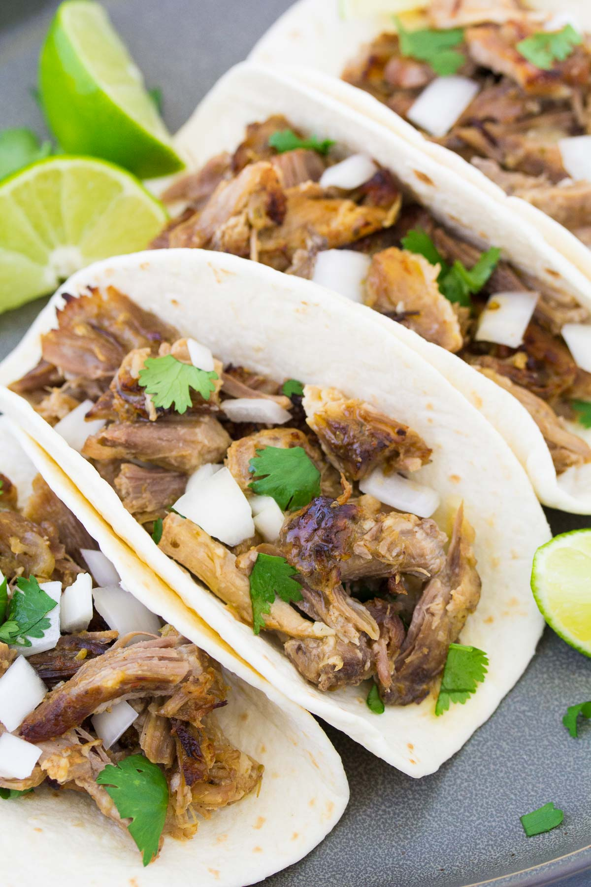 Instant Pot carnitas tacos with onion and cilantro.