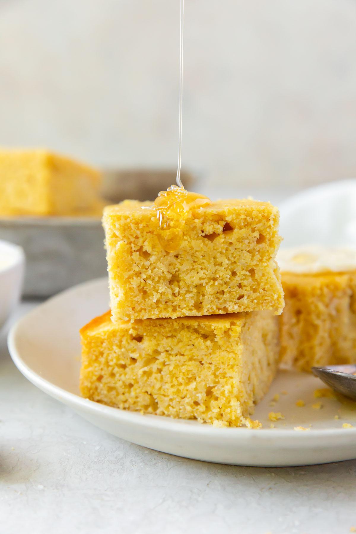drizzling honey onto cornbread slices