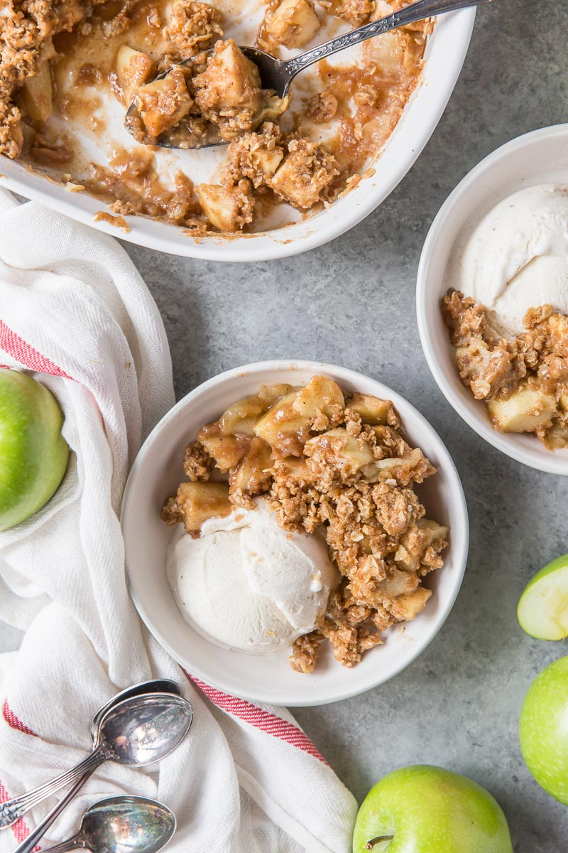 apple crisp in serving bowls with ice cream