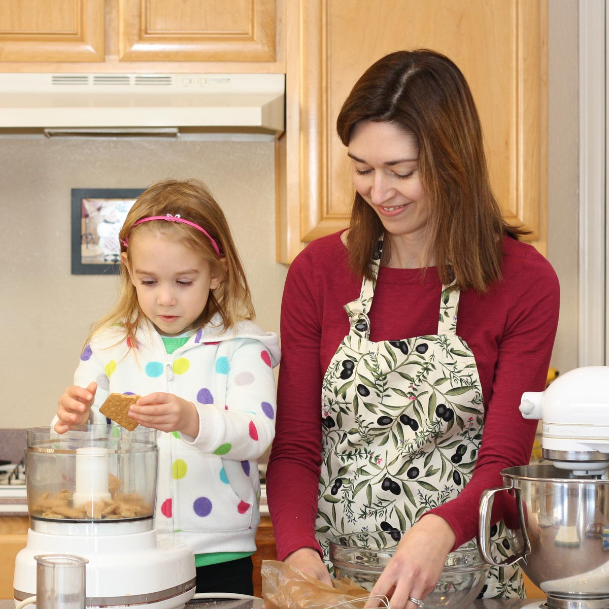 Kristine baking with daughter