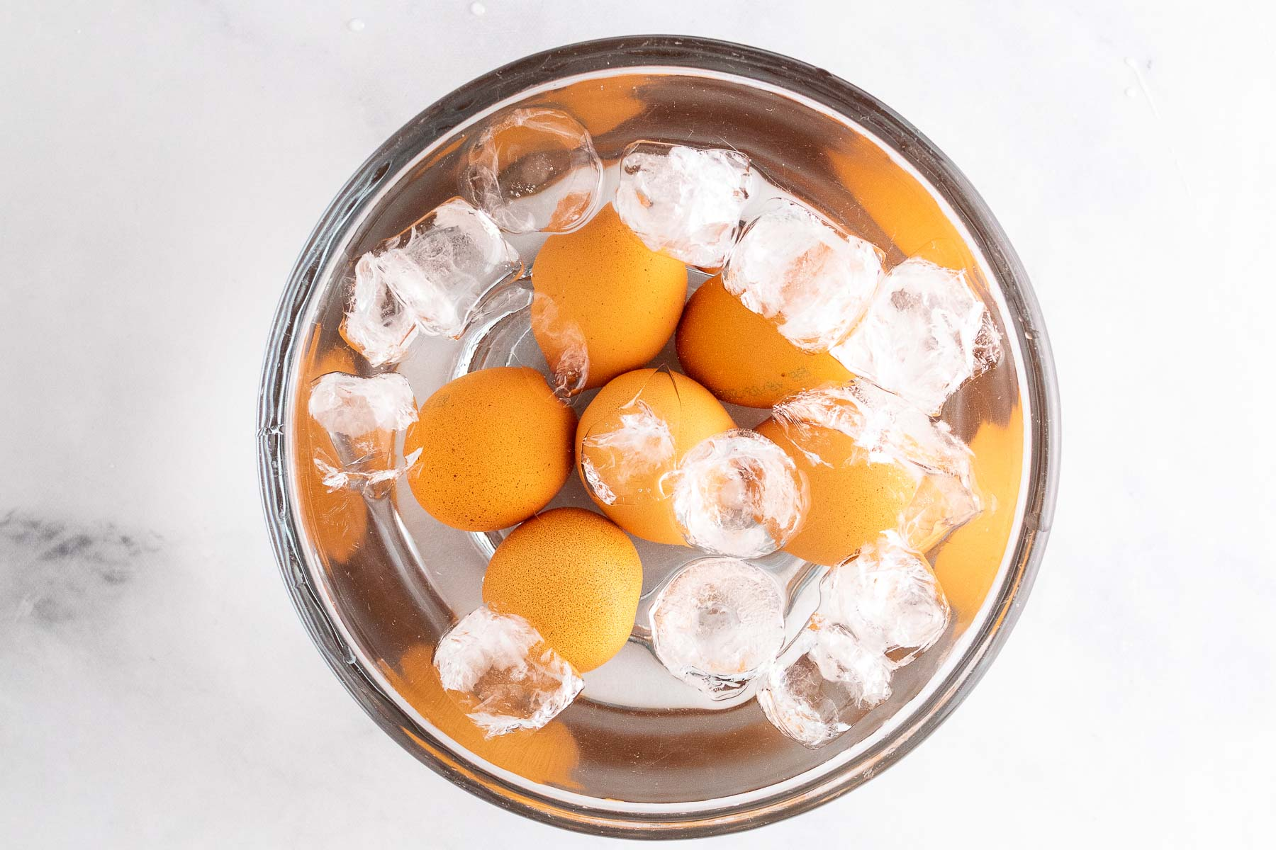 hard boiled eggs in bowl of ice water