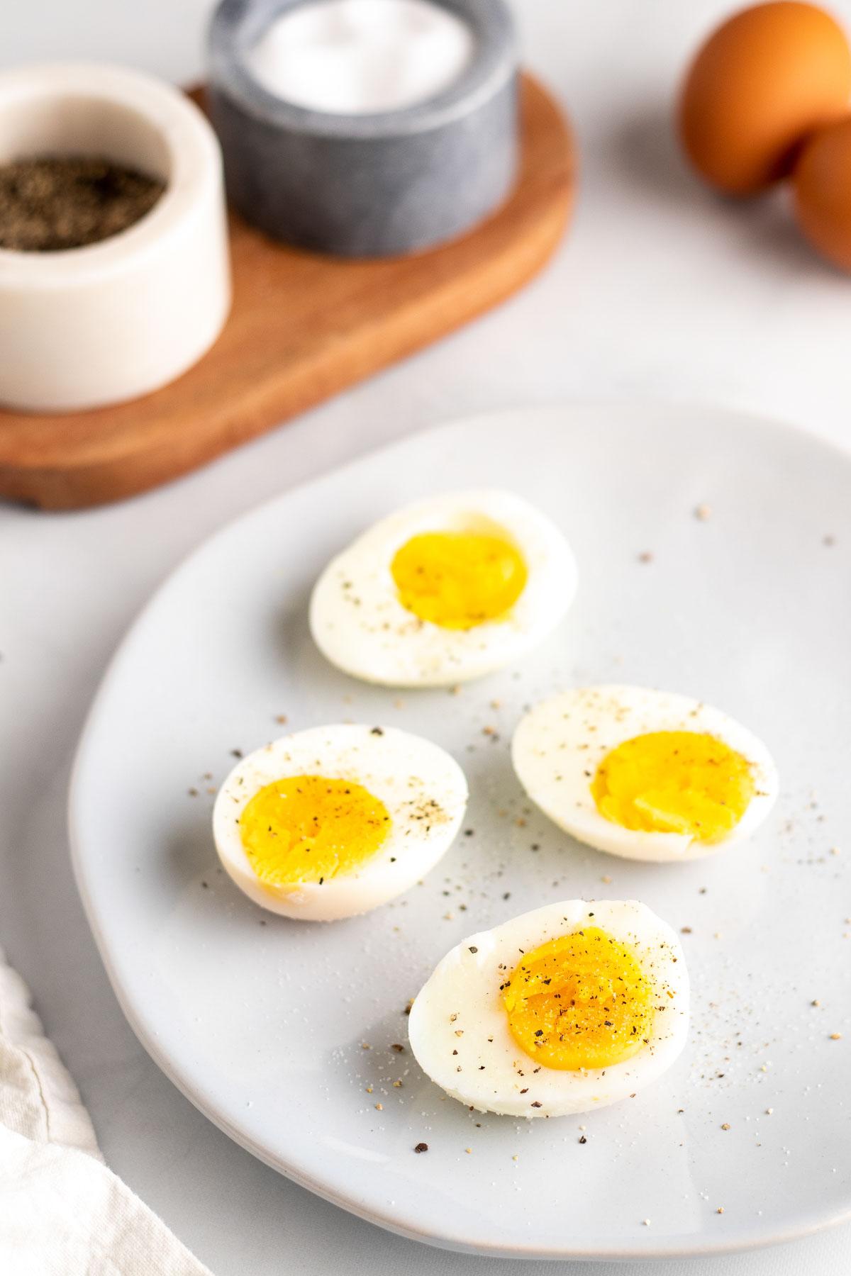 halved hard boiled eggs sprinkled with salt and pepper