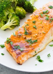 baked salmon served with broccoli