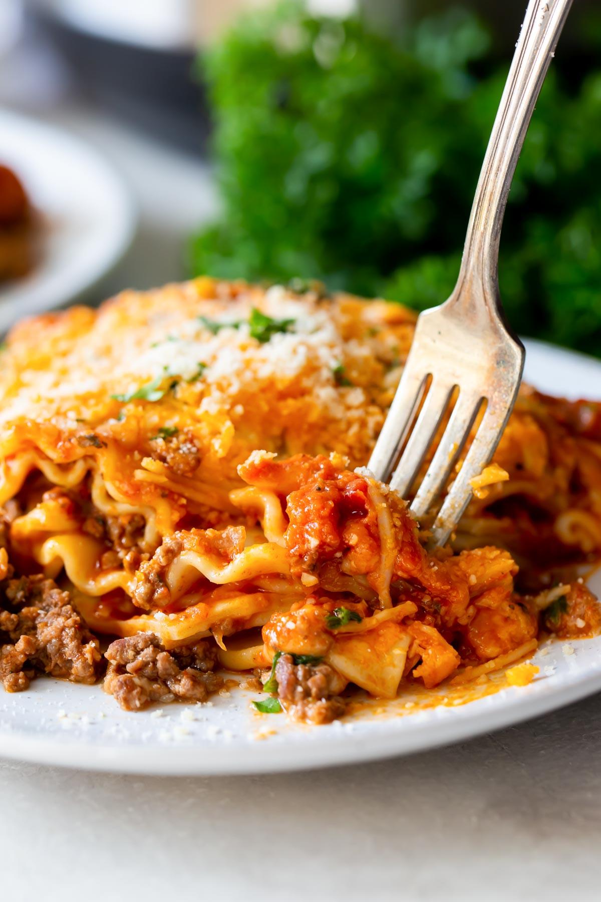 fork taking a bite of lasagna