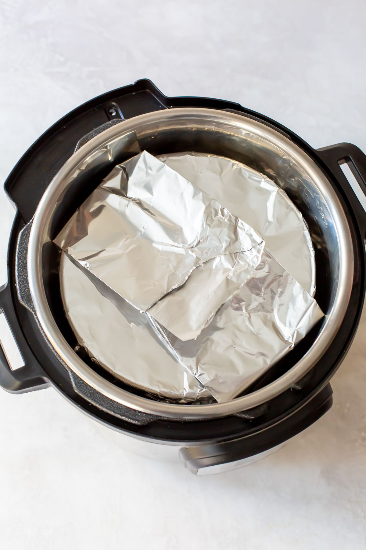 cheesecake covered with foil in instant pot