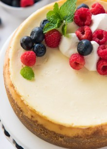 instant pot cheesecake topped with whipped cream and berries