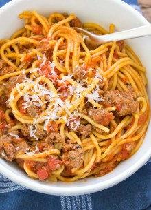instant pot spaghetti with meat sauce and parmesan in a bowl