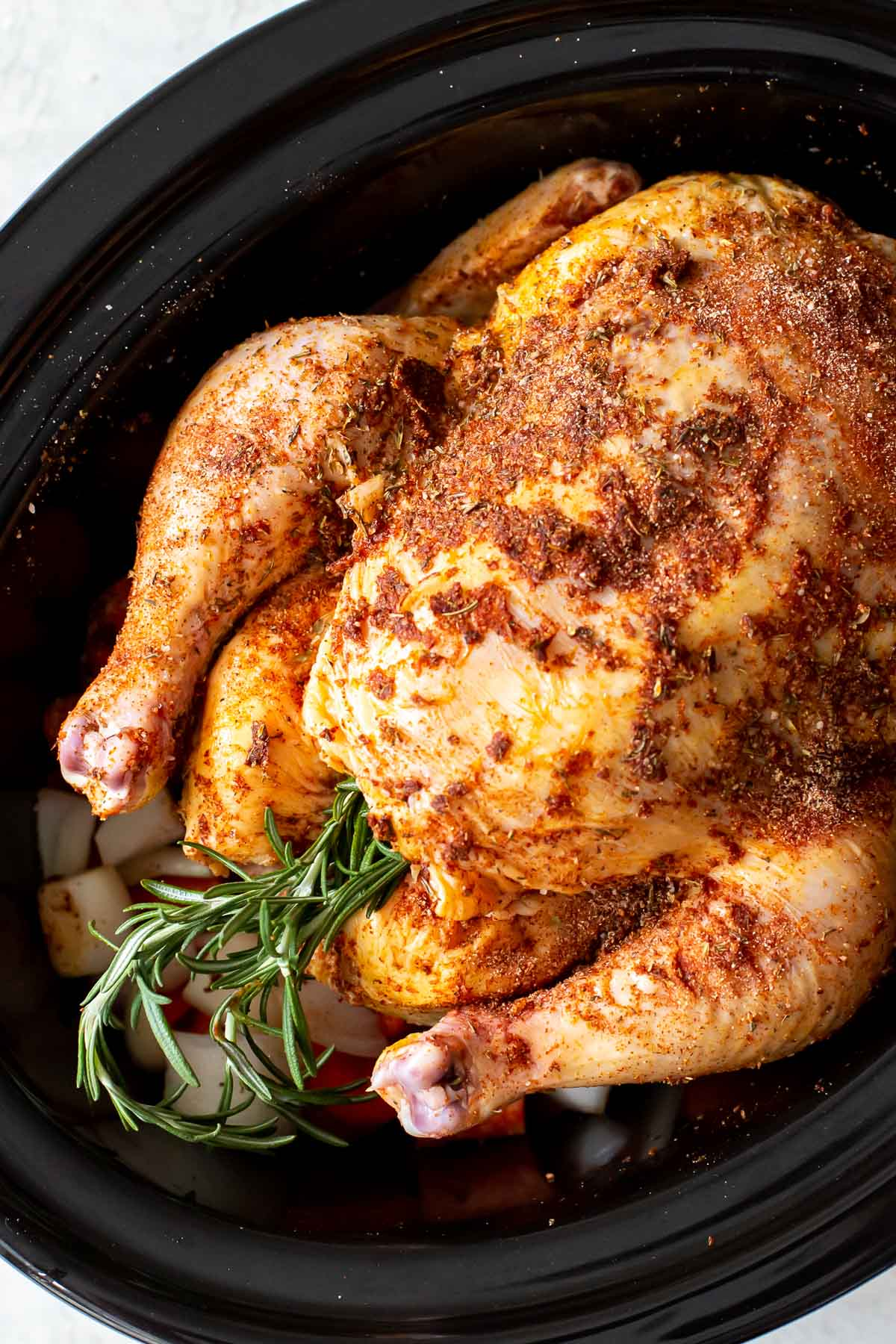 whole chicken in slow cooker before cooking